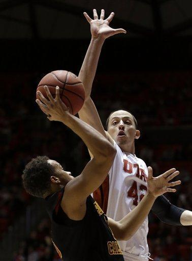 Utah center Jason Washburn (42) goes up to block the shot of Southern California guard Chass Bryan, left, in the first half during an NCAA basketball game Saturday, Jan. 12, 2013, in Salt Lake City. (AP Photo/Rick Bowmer)