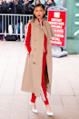 <p>Here's a lesson on how to take your tracksuit from the sofa to front row at New York Fashion Week. Layer under a trench coat, add a swipe of red lippy and swap your slippers for crisp pumps.</p>