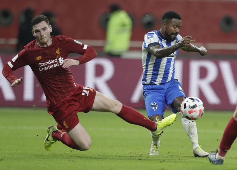Monterrey's Dorlan Pabon shoots by Liverpool's Andrew Robertson during the Club World Cup semifinal soccer match between Liverpool and Monterrey at the Khalifa International Stadium in Doha, Qatar, Wednesday, Dec. 18, 2019. (AP Photo/Hassan Ammar)
