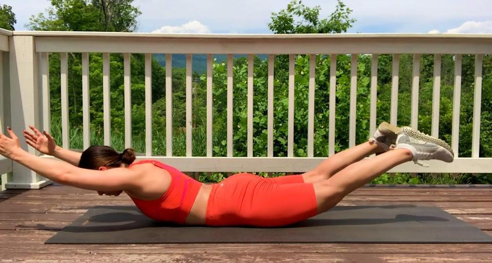 <ul> <li>Lie on your belly, and extend your arms straight out in front of you.</li> <li>Pull your belly button into your spine.</li> <li>Lift your legs, arms, and chest off of the floor, squeezing your glutes and legs as you do and keeping your arms by your ears.</li> <li>Hold this position for five seconds before lowering to the ground.</li> </ul>