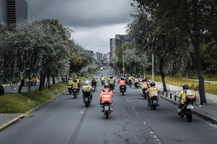 """Delivery drivers driving in an empty avenue during a global drivers protest on May 29th in Quito, Ecuador Drivers from eleven countries, most of them in Latin America, protested under the motto """"I wont deliver"""" They demad fair payments and securities for their work. """"I won't deliver."""" They demad fair payments and securities for their work."""