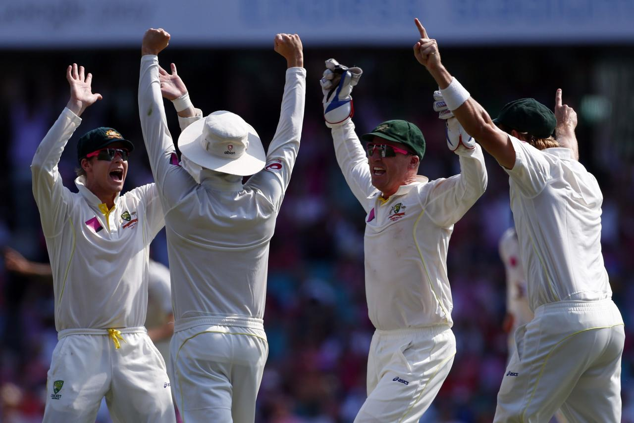 Australia's Steven Smith (L) captain Michael Clarke (2nd L) , Brad Haddin (2nd R) and Shane Watson celebrate after winning the fifth Ashes cricket test against England at the Sydney Cricket Ground January 5, 2014. A rampant Australia sealed a 5-0 Ashes series sweep by skittling England out for 166 to claim a 281-run victory with more than two days to spare in the fifth test at the Sydney Cricket Ground on Sunday. REUTERS/David Gray (AUSTRALIA - Tags: SPORT CRICKET TPX IMAGES OF THE DAY)