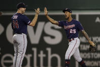Minnesota Twins' C.J. Cron (24) and Byron Buxton (25) celebrate the team's 6-5 victory over the Boston Red Sox in a baseball game at Fenway Park, Tuesday, Sept. 3, 2019, in Boston. (AP Photo/Elise Amendola)