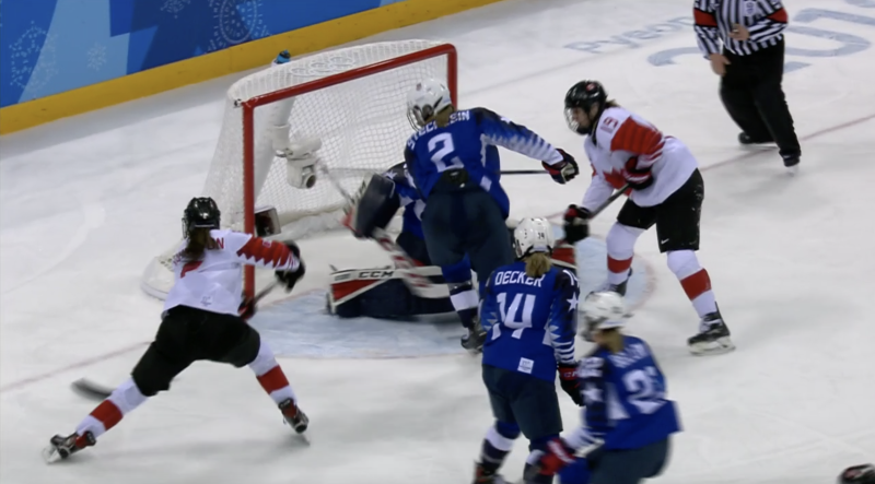 Canadian ice hockey star Jocelyne Larocque rips off her silver medal