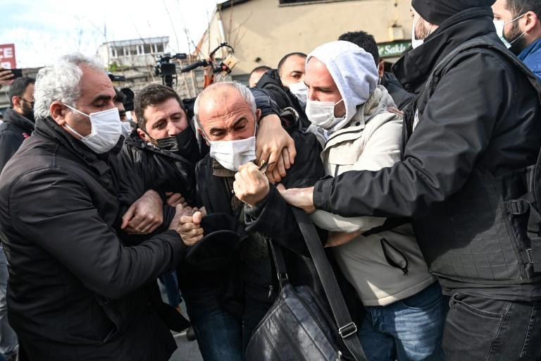 Turkish plain-clothed police officers hold protesters during a demonstration in support of Bogazici University students on February 11, 2011