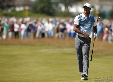 Tiger Woods of the U.S. watches his shot during the first round of the British Open Championship at the Royal Liverpool Golf Club in Hoylake