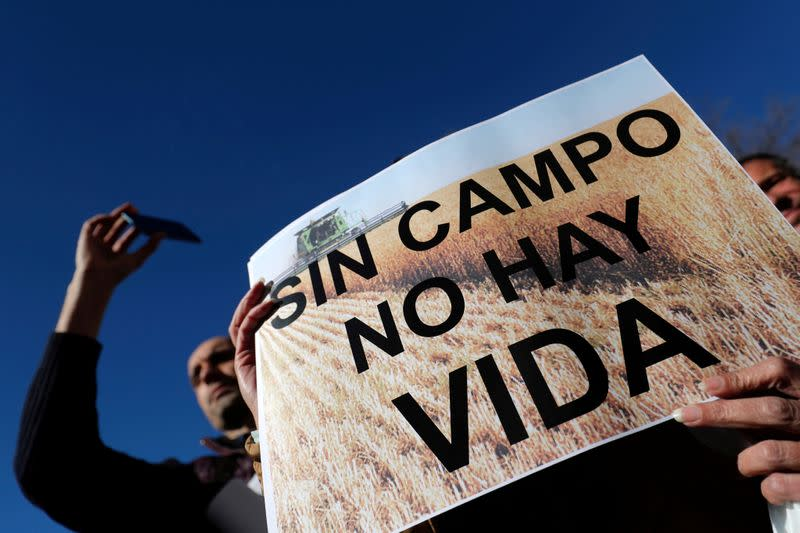 Spanish farmers and ranchers protest outside the Ministry of Agriculture in Madrid