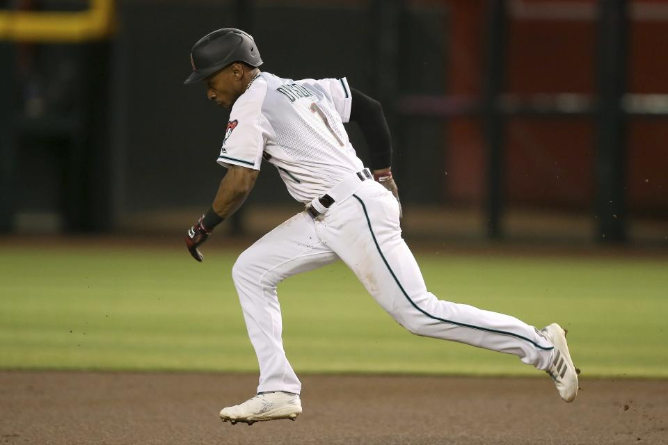 Arizona Diamondbacks' Jarrod Dyson takes off for second base for a stolen base against the Los Angeles Dodgers during the first inning of a baseball game Friday, Aug. 30, 2019, in Phoenix. (AP Photo/Ross D. Franklin)