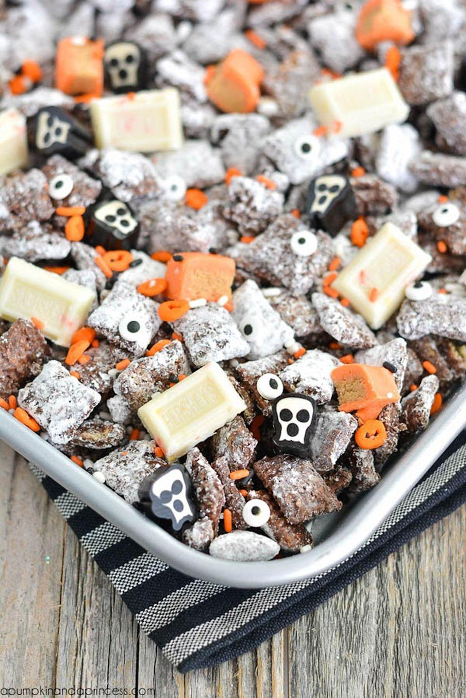 """<p>This festive mix will be your go-to snack during <a href=""""https://www.countryliving.com/life/entertainment/g3624/best-halloween-movies/"""" rel=""""nofollow noopener"""" target=""""_blank"""" data-ylk=""""slk:Halloween movie marathons"""" class=""""link rapid-noclick-resp"""">Halloween movie marathons</a>. <br></p><p><strong>Get the recipe at <a href=""""https://apumpkinandaprincess.com/halloween-muddy-buddies/"""" rel=""""nofollow noopener"""" target=""""_blank"""" data-ylk=""""slk:A Pumpkin and a Princess"""" class=""""link rapid-noclick-resp"""">A Pumpkin and a Princess</a>.</strong> </p>"""
