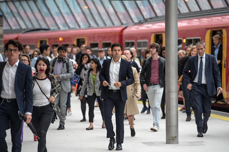 LONDON, ENGLAND - AUGUST 07: Commuters walk along a platform at Waterloo Train Station on August 7, 2017 in London, England. Ten platforms at London Waterloo, Britain's busiest train station, will be shut until 28 August to enlarge station capacity. The 800 million GBP project will prepare the station for longer trains and provide space for 30 percent more passengers during the busiest times of the day. (Photo by Carl Court/Getty Images)