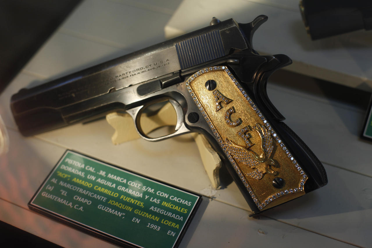 "A gun, seized from drug lord Joaquin Guzman Loera, also known as ""El Chapo Guzman"", is displayed at the drug museum, created to honor the fight against drug trafficking, at the Secretary of Defense headquarters in Mexico City, Wednesday, Aug. 18, 2010.  (AP Photo/Alexandre Meneghini)"