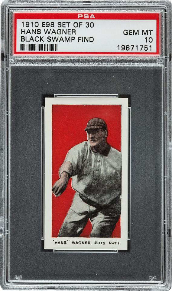 FILE - This undated file photo provided by Heritage Auctions of Dallas, shows a 1910 Honus Wagner baseball card found in the attic of a house in Defiance, Ohio. The discovery of century-old baseball cards in an Ohio attic isn't going to make anyone super-rich even though it's being called one of the most exciting finds in the history of sports card collecting. That's because the cards and the money are being evenly divided among 20 cousins. (AP Photo/ Heritage Auctions, FILE)