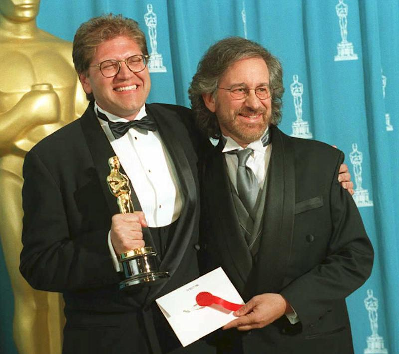 Director Robert Zemeckis (L) holds the Oscar he won as best director for the film Forrest Gump, which also won Best Picture, as he poses with Steven Spielberg. (Dan Groshong/AFP via Getty Images)