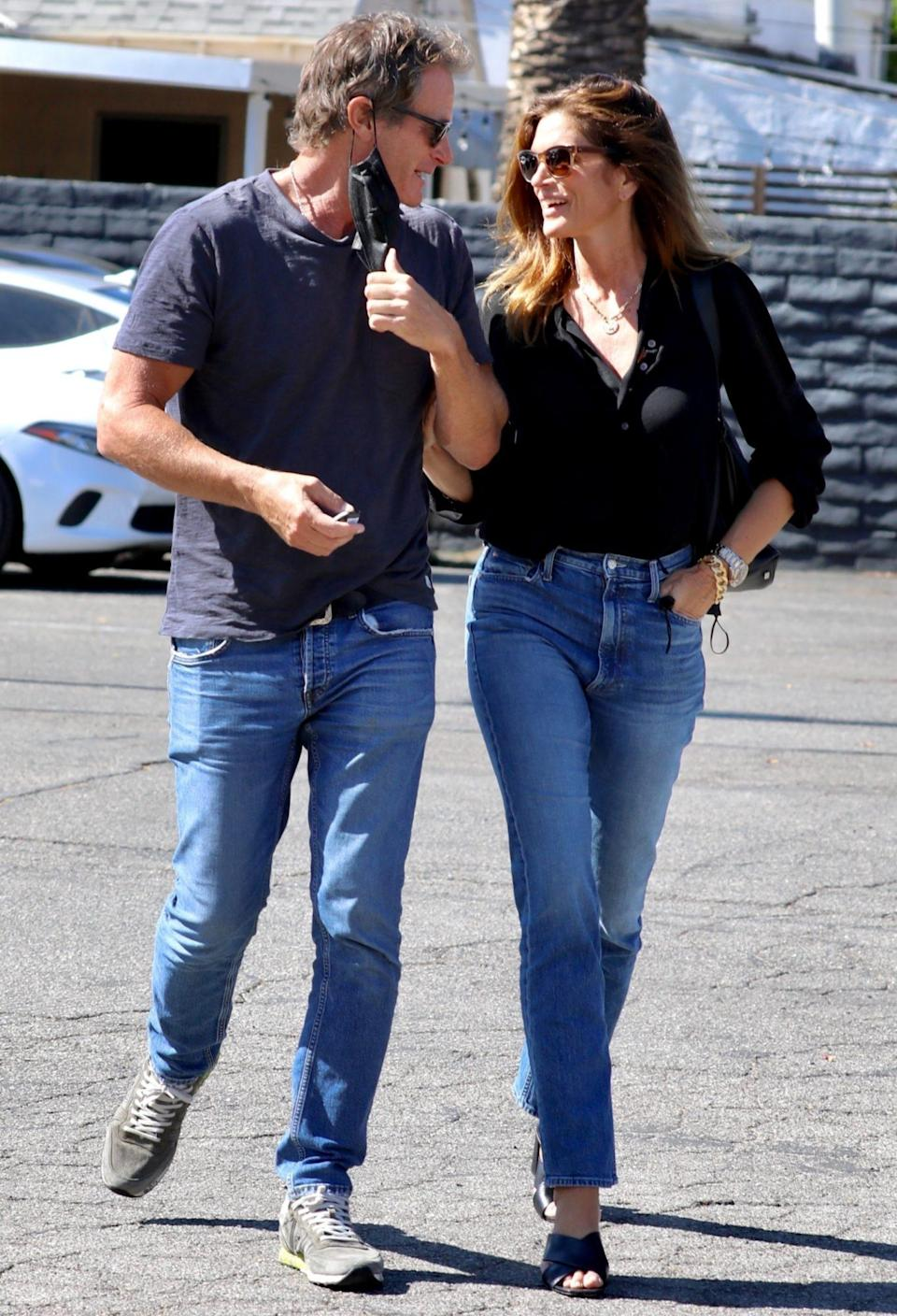 <p>Rande Gerber and Cindy Crawford share a sweet moment while shopping in West Hollywood on July 29.</p>