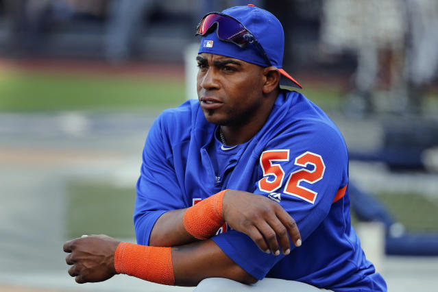 FILE - In this July 20, 2018, file photo, New York Mets' Yoenis Cespedes stretches before a baseball game against the New York Yankees in New York. When baseball comes back next month, Cespedes might finally be ready to return, too. Sidelined for nearly two years by injuries and then the coronavirus pandemic, the Mets slugger could be healthy enough at last to play on opening day in late July especially with the designated hitter available in the National League this season. General manager Brodie Van Wagenen said Monday, June 29, 2020, the team is optimistic about Cspedes. (AP Photo/Julie Jacobson, File)