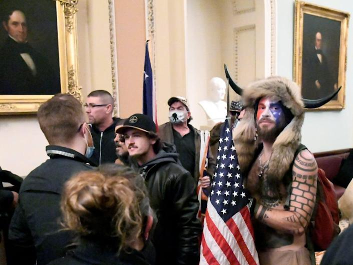"""<div class=""""inline-image__caption""""><p>Jacob Chansley on the second floor of the U.S. Capitol on Jan. 6.</p></div> <div class=""""inline-image__credit"""">Reuters</div>"""