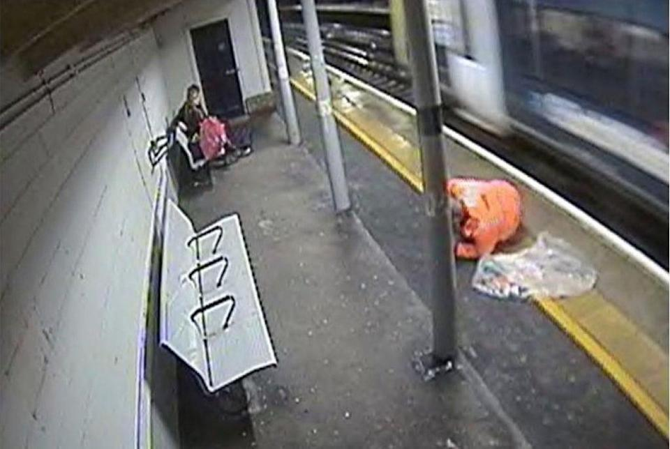 A rail worker removing rubbish from train tracks narrowly avoided being hit by a train, an investigation has found (RAIB/PA) (PA Media)
