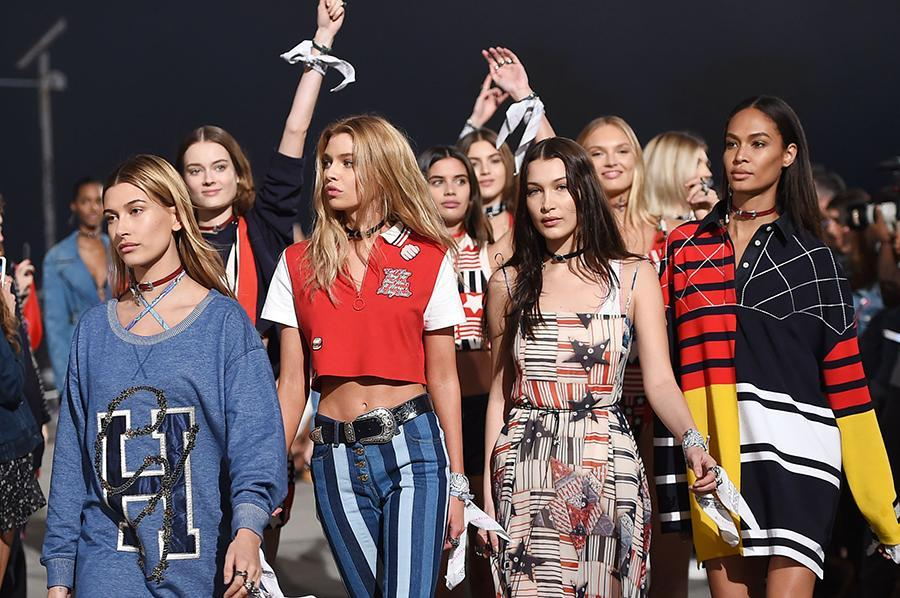 <p>At the Tommy x Gigi show in Los Angeles, models donned white bandannas in support of the Business of Fashion's #TiedTogether movement, meant to represent solidarity, unity, and inclusiveness. Audience members were also given bandannas. (Photo: Getty Images) </p>