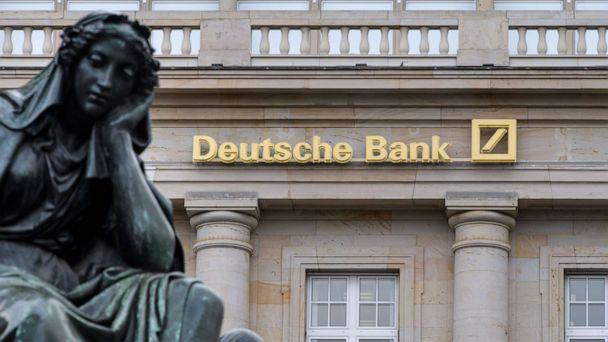PHOTO: A branch of the German bank Deutsche Bank pictured with a sculpture of the 'Gutenberg' monument, Feb. 1, 2018, in Frankfurt. (Thomas Lohnes/Getty Images, FILE)