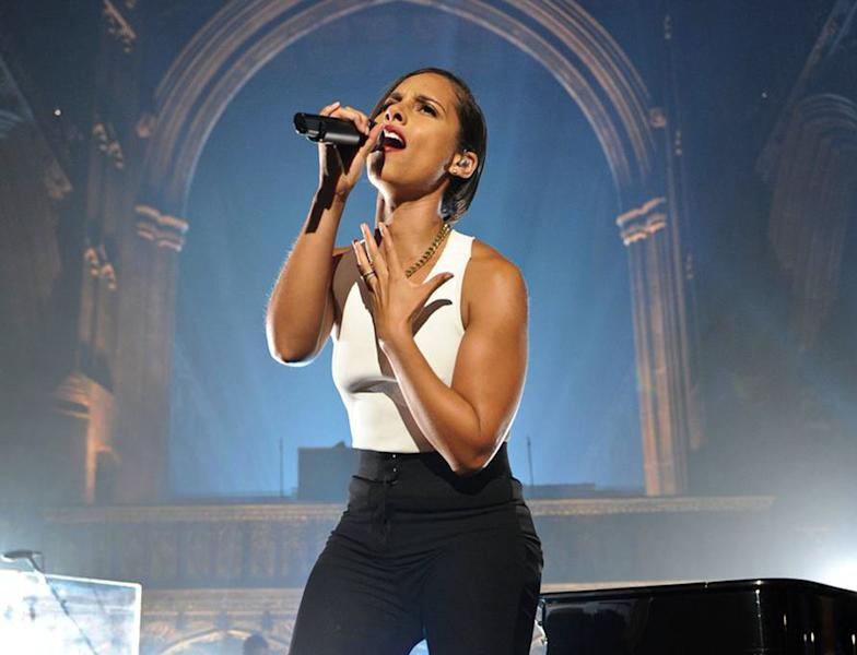 "FILE - This Sept. 24, 2012 image released by MTV Crashes Manchester shows Alicia Keys headlining ""MTV Crashes Manchester"" in the city's cathedral, Manchester, England. Keys and Dionne Warwick are known for singing pop and R&B, but they'll be honored as black women who ""rock"" on BET. The ""Black Girls Rock!"" special, which honors the accomplishments of black women, returns to the network on Nov. 4; the actual ceremony will be held Oct. 13 in the Bronx, N.Y., with actresses Tracee Ellis Ross and Regina King returning as hosts. (AP Photo/Andrew Timms/MTV Crashes Manchester)"