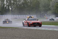 Red Bull driver Max Verstappen of the Netherlands follows the safety car during the Emilia Romagna Formula One Grand Prix, at the Imola racetrack, Italy, Sunday, April 18, 2021. (AP Photo/Luca Bruno)