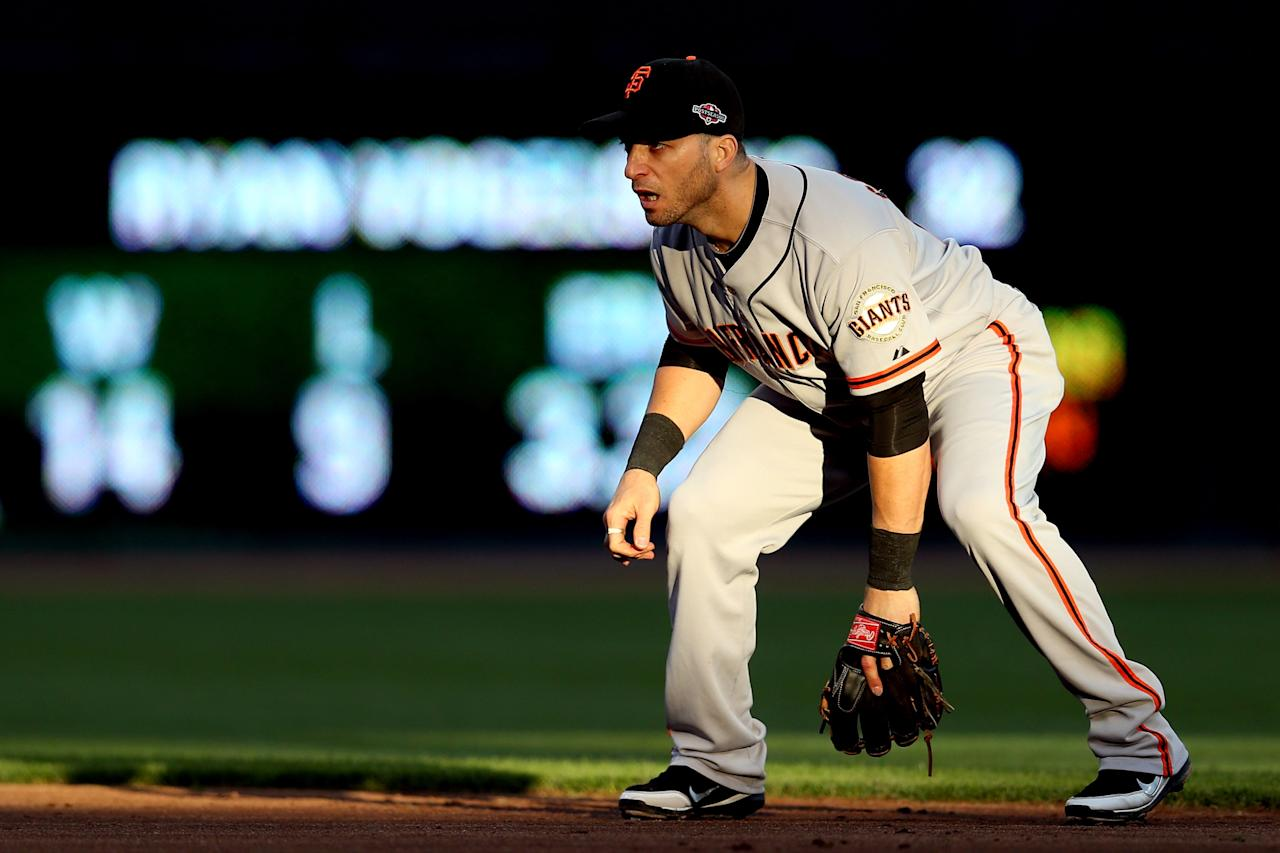 CINCINNATI, OH - OCTOBER 09:  Marco Scutaro #19 of the San Francisco Giants plays defense in the first inning against the Cincinnati Reds in Game Three of the National League Division Series at the Great American Ball Park on October 9, 2012 in Cincinnati, Ohio.  (Photo by Jonathan Daniel/Getty Images)
