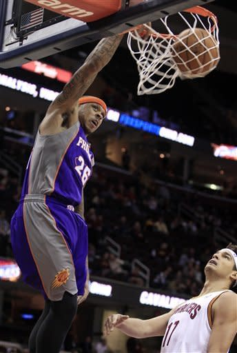 Phoenix Suns' Shannon Brown (26) dunks in front of Cleveland Cavaliers' Anderson Varejao during the first quarter in an NBA basketball game Tuesday, Nov. 27, 2012, in Cleveland. (AP Photo/Tony Dejak)