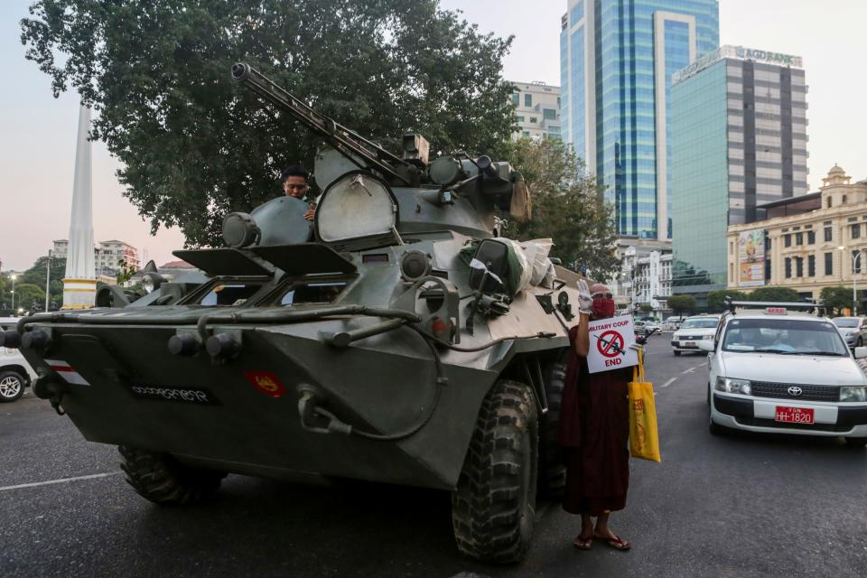 An armoured vehicle drives pasto the Sule Pagoda Sunday, following days of mass protests against the military coup. Source: AFP