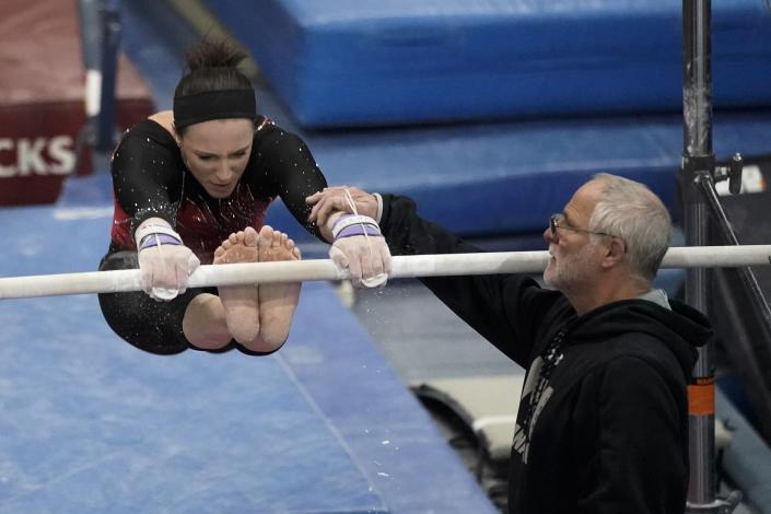 Former world champion and Olympic silver medalist Chellsie Memmel works out with her father and coach Andy Memmel Thursday, Feb. 18, 2021, in New Berlin, Wisc. (AP Photo/Morry Gash)