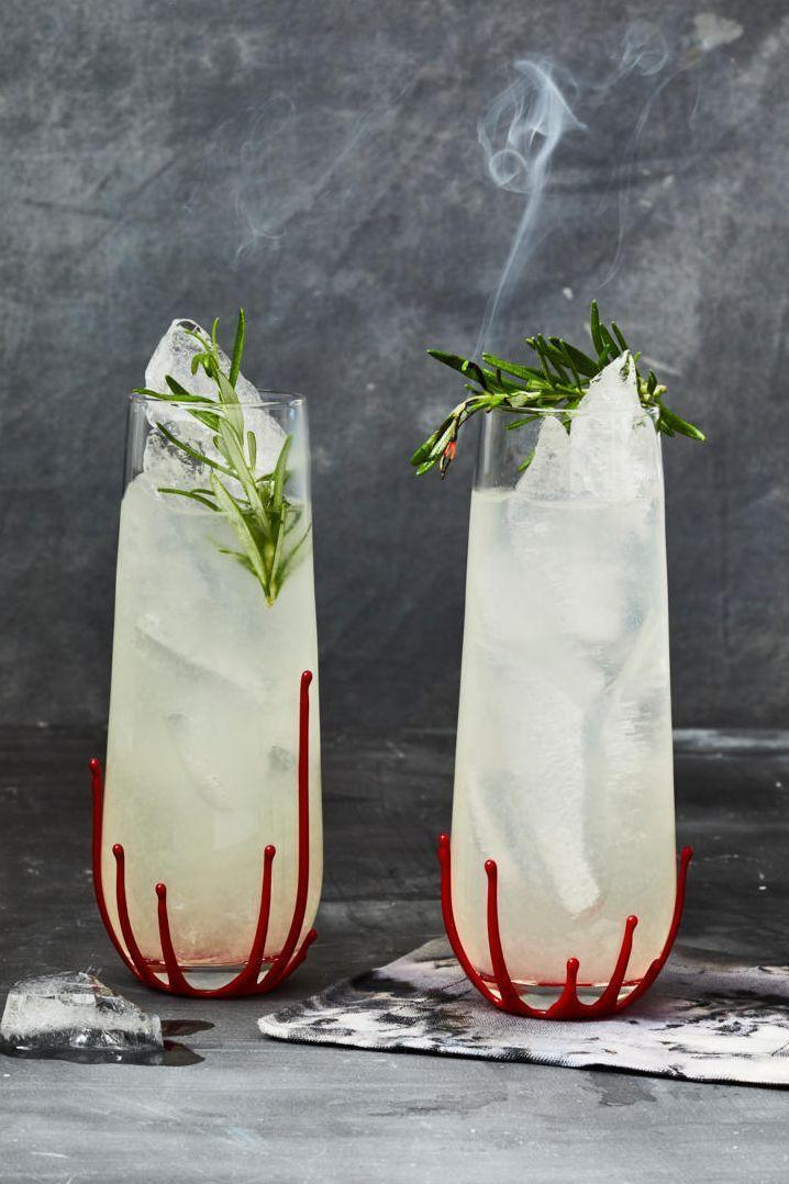 """<p>Three cheers for an herbal cocktail! Get ready to say hip, hip hooray for this sweet yet sour herb-infused libation. Garnish your glass with a sprig of rosemary as a final touch.<br><br><em><a href=""""https://www.goodhousekeeping.com/food-recipes/a37116577/rosemary-gin-gimlet-recipe/"""" rel=""""nofollow noopener"""" target=""""_blank"""" data-ylk=""""slk:Get the recipe for a Rosemary Gin Gimlet »"""" class=""""link rapid-noclick-resp"""">Get the recipe for a Rosemary Gin Gimlet »</a></em><br></p>"""