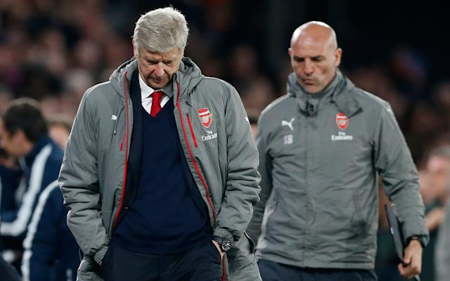 A dejected Arsene Wenger trudges off the Selhurst Park pitch Credit: Reuters