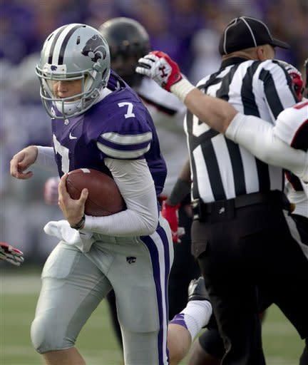 Kansas State quarterback Collin Klein (7) takes advantage of umpire Scott Campbell on his way to a touchdown run during the second half of an NCAA college football game against Texas Tech in Manhattan, Kan., Saturday, Oct. 27, 2012. Kansas State defeated Texas Tech 55-24. (AP Photo/Orlin Wagner)