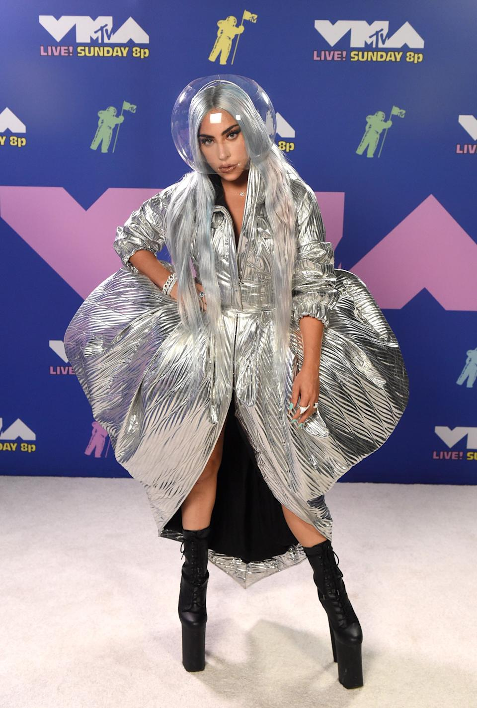Lady Gaga kept her red carpet outfit COVID-safe with what looked like a space helmet with a futuristic silver dress. Photo: Getty