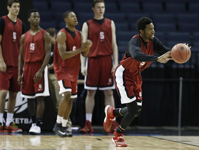 Stanford's Chasson Randle, right, works out during practice at the NCAA college basketball tournament, Wednesday, March 26, 2014, in Memphis, Tenn. Stanford plays Dayton in a regional semifinal on Thursday. (AP Photo/Mark Humphrey)