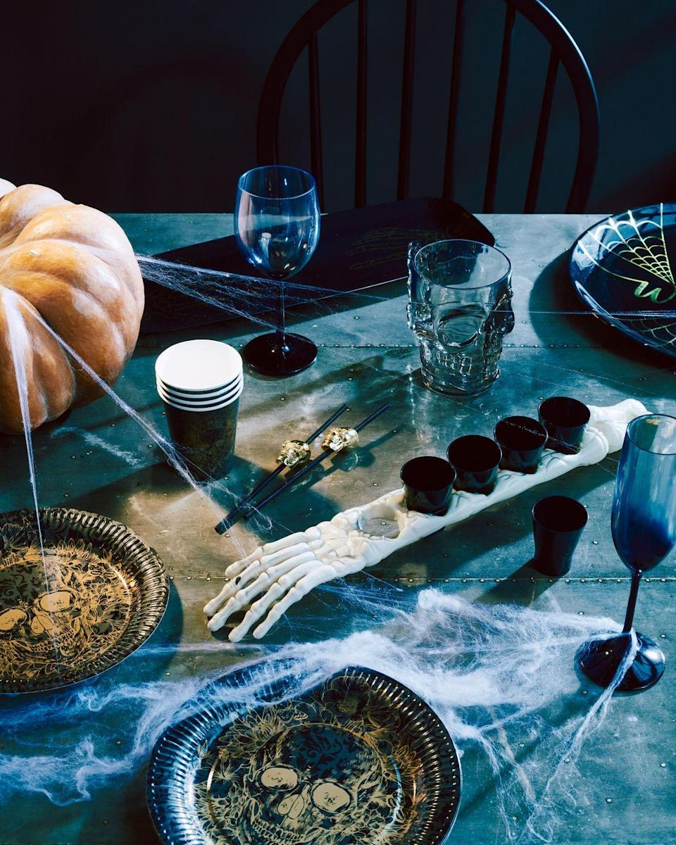 """<p>Whilst not a new trend, Sainsbury's is also stocking a whole host of spooky homeware accessories ahead of <a href=""""https://www.housebeautiful.com/uk/decorate/looks/g33883780/best-halloween-decorations/"""" rel=""""nofollow noopener"""" target=""""_blank"""" data-ylk=""""slk:Halloween"""" class=""""link rapid-noclick-resp"""">Halloween</a>. Choose from candles, cups and plates adorned with skulls and <a href=""""https://www.housebeautiful.com/uk/lifestyle/a28896708/pumpkin-patches-near-london/"""" rel=""""nofollow noopener"""" target=""""_blank"""" data-ylk=""""slk:pumpkins"""" class=""""link rapid-noclick-resp"""">pumpkins</a> alike. Trick-or-treat, anyone? </p><p><strong>Hot On The High Street:</strong> Shop our <a href=""""https://www.housebeautiful.com/uk/lifestyle/shopping/g31077271/cheap-home-decor/"""" rel=""""nofollow noopener"""" target=""""_blank"""" data-ylk=""""slk:weekly edit of stylish homeware for under £35"""" class=""""link rapid-noclick-resp"""">weekly edit of stylish homeware for under £35</a>. And don't forget to join us on <a href=""""https://www.instagram.com/housebeautifuluk/"""" rel=""""nofollow noopener"""" target=""""_blank"""" data-ylk=""""slk:Instagram"""" class=""""link rapid-noclick-resp"""">Instagram</a> – share the way you're styling your home with high street buys using <a href=""""https://www.instagram.com/explore/tags/hbhighstreet/"""" rel=""""nofollow noopener"""" target=""""_blank"""" data-ylk=""""slk:#HBhighstreet"""" class=""""link rapid-noclick-resp"""">#HBhighstreet</a>!</p><p><strong>Like this article? </strong><a href=""""https://hearst.emsecure.net/optiext/cr.aspx?ID=DR9UY9ko5HvLAHeexA2ngSL3t49WvQXSjQZAAXe9gg0Rhtz8pxOWix3TXd_WRbE3fnbQEBkC%2BEWZDx"""" rel=""""nofollow noopener"""" target=""""_blank"""" data-ylk=""""slk:Sign up to our newsletter"""" class=""""link rapid-noclick-resp""""><strong>Sign up to our newsletter</strong></a><strong> to get more articles like this delivered straight to your inbox.</strong></p><p><a class=""""link rapid-noclick-resp"""" href=""""https://hearst.emsecure.net/optiext/cr.aspx?ID=DR9UY9ko5HvLAHeexA2ngSL3t49WvQXSjQZAAXe9gg0Rhtz8pxOWix3TXd_WRbE3fnbQEBkC%2BEWZDx"""" rel=""""nofol"""
