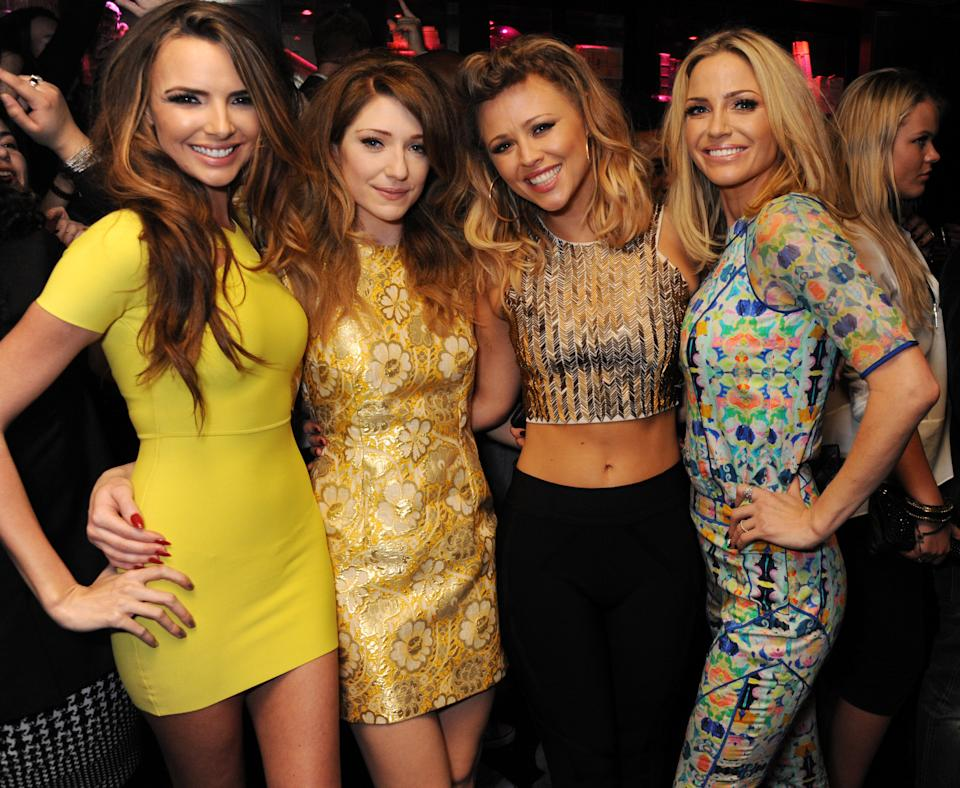 LONDON, ENGLAND - MARCH 02:  (EMBARGOED FOR PUBLICATION IN UK TABLOID NEWSPAPERS UNTIL 48 HOURS AFTER CREATE DATE AND TIME. MANDATORY CREDIT PHOTO BY DAVE M. BENETT/GETTY IMAGES REQUIRED) (L-R) Nicola Roberts, Nadine Coyle, Kimberley Walsh and Sarah Harding of Girls Aloud attend their London Ten - The Hits Tour after party at Whisky Mist Club on March 02, 2013 in London, England. (Photo by Dave M. Benett/Getty Images)