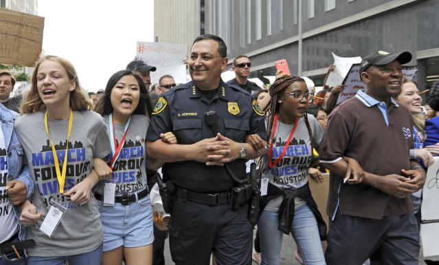 <p>Houston Police Chief Art Acevedo, center, and Houston Mayor Sylvester Turner, far right, join demonstrators during a March for Our Lives in Houston, Texas. (AP Photo/David J. Phillip) </p>
