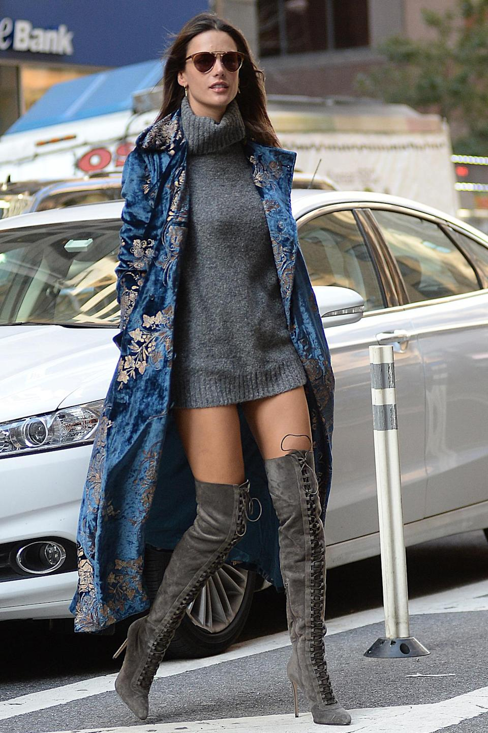 """<p>The 35-year-old model stepped out for a fitting in Manhattan on Nov. 1 wearing thigh-high boots, a dangerously short turtleneck """"dress"""" and a velvet coat. Because when you're a Victoria's Secret Angel….you don't really need pants. <i>(Photo by Splash News)</i><br></p>"""