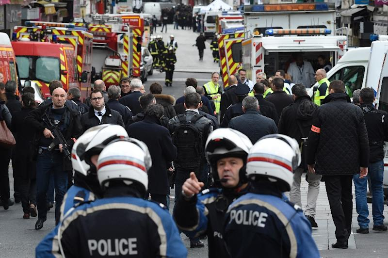 Policemen and firefighters swarm the northern Paris suburb of Saint-Denis on November 18, 2015, as the emergency services see a spike in interest from young potential recruits in the wake of the November 13 jihadist attacks on Paris (AFP Photo/Lionel Bonaventure)