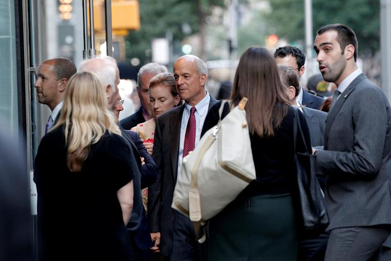 People stand outside the Le Cirque restaurant as they arrive for a fundraising event for Republican presidential candidate Donald Trump in New York