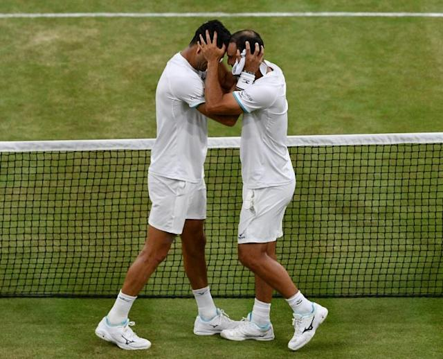 Juan Sebastian Cabal and Robert Farah celebrate winning their first Grand Slam at Wimbledon (AFP Photo/Daniel LEAL-OLIVAS)