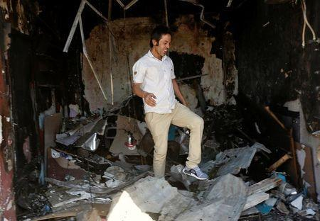 An Afghan shopkeeper inspects his shop after a suicide attack in Kabul, Afghanistan, July 24, 2017. REUTERS/Omar Sobhani
