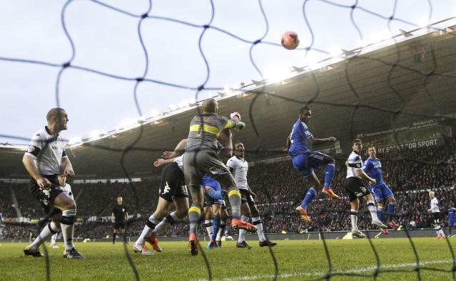 Chelsea's John Mikel Obi (3rd R) heads and scores his goal against Derby County during their English FA Cup soccer match at the iPro Stadium in Derby, central England January 5, 2014. REUTERS/Darren Staples (BRITAIN - Tags: SPORT SOCCER TPX IMAGES OF THE DAY)