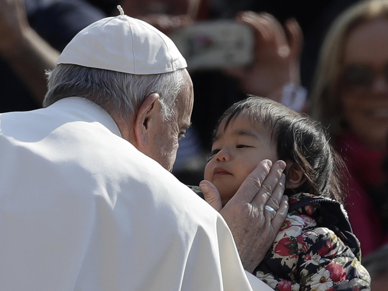 <p>Pope Francis carresses a child as he tours through the crowd in St. Peter's Square during his weekly general audience, at the Vatican, April 5, 2017. (Photo: Alessandra Tarantino/AP) </p>