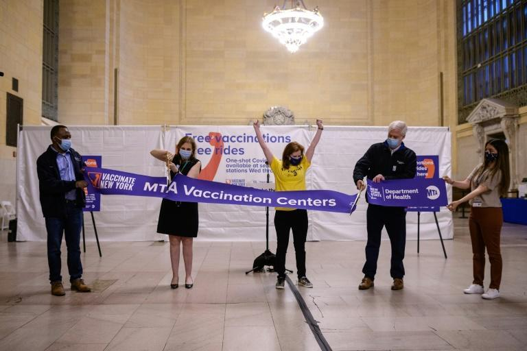 Metropolitan Transportation Authority Chairman and CEO Patrick Foye (2nd R) and Metro-North Railroad President Catherine Rinaldi (2nd L) hold a ribbon-cutting ceremony at a temporary Covid-19 vaccination site at Grand Central Terminal train station on May 12, 2021 in New York City