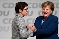 Annegret Kramp-Karrenbauer is embraced by German Chancellor Angela Merkel after being elected as the party leader during the Christian Democratic Union (CDU) party congress in Hamburg, Germany, December 7, 2018. REUTERS/Fabian Bimmer
