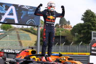 First placed Red Bull's Max Verstappen celebrates at the end of the Emilia Romagna Formula One Grand Prix, at the Imola racetrack, Italy, Sunday, April 18, 2021. (Bryn Lennon/ Pool Via AP)