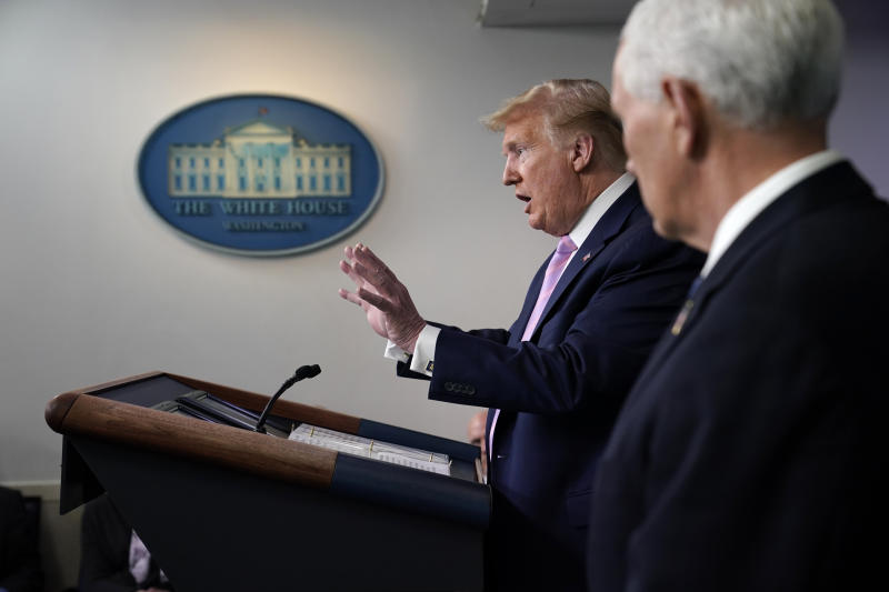 Vice President Mike Pence listens as President Donald Trump speaks during a coronavirus task force briefing at the White House, Friday, April 10, 2020, in Washington. (AP Photo/Evan Vucci)