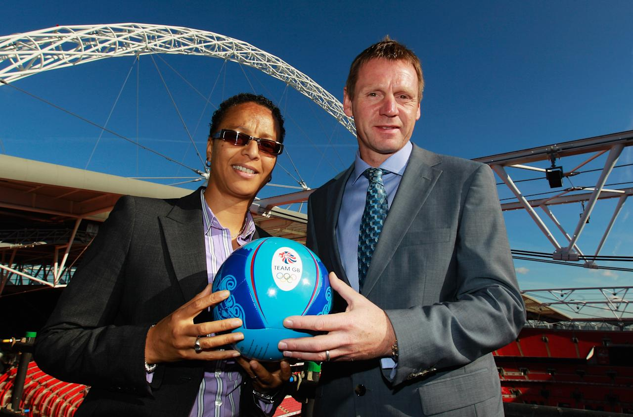 LONDON, ENGLAND - OCTOBER 20:  Hope Powell and Stuart Pearce pose together following a press conference to announce the Men's and Women's Football Team managers of Great Britain for the London 2012 Olympics at Wembley Stadium on October 20, 2011 in London, England.  (Photo by Paul Gilham/Getty Images)