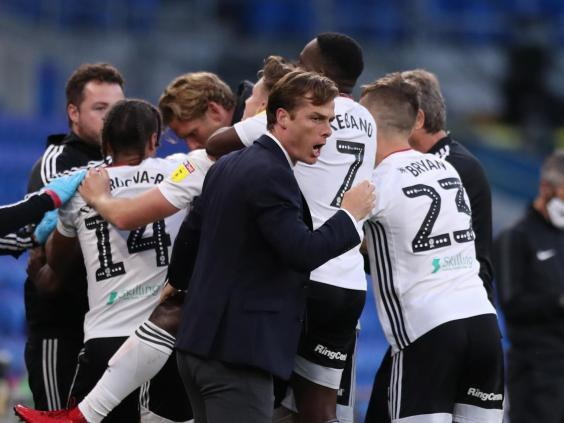 Scott Parker, manager of Fulham, celebrates with is players (Getty Images)